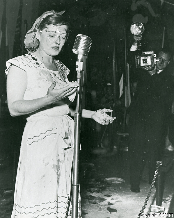 1944 Bette Davis on stage after taking a pie in the face during a skit at the Hollywood Canteen