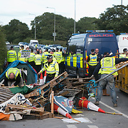13 local activists locked themselves in specially made arm tubes to block the entrance to Quadrilla's drill site in New Preston Road, July 03 2017, Lancashire, United Kingdom. The 13 activists included 3 councillors; Julie Brickles, Miranda Cox and Gina Dowding and Nick Danby, Martin Porter, Jeanette Porter,  Michelle Martin, Louise Robinson,<br /> Alana McCullough, Nick Sheldrick, Cath Robinson, Barbara Cookson, Dan Huxley-Blyth. The blockade is a repsonse to the emmidiate drilling for shale gas, fracking, by the fracking company Quadrilla. Lancashire voted against permitting fracking but was over ruled by the conservative central Government. All the activists have been active in the struggle against fracking for years but this is their first direct action of peacefull protesting. Fracking is a highly contested way of extracting gas, it is risky to extract and damaging to the environment and is banned in parts of Europe . Lancashire has in the past experienced earth quakes blamed on fracking. (photo by Kristian Buus/In Pictures via Getty Images)