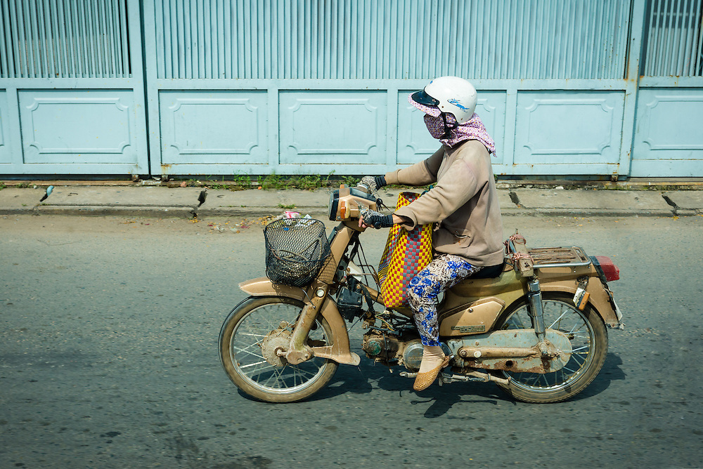 Woman riding motorcycle outside of Ho Chi Minh City