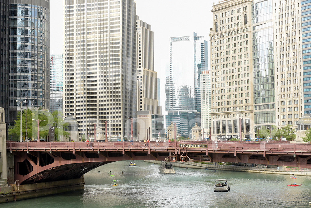 Boat traffic sails under a bridge along the Chicago River in Chicago, Illinois. Photo by Mark Black