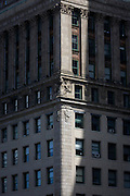 Century old ornate apartment building built in stone, in Manhattan, New York City.