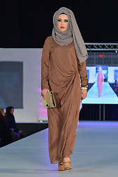 © Licensed to London News Pictures. 23/11/2013, UK. Islamic Design House, Saverah Islamic Fashion Weekend, Global Peace & Unity Event, Excel, London UK, 23 November 2013. Photo credit : See Li/Piqtured/LNP