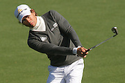 08 April 2009: Camilo Villegas follows through after sticking a chip pin high on hole #2. The final practice round of the 2009 Masters. Players play multiple balls from many different angles in an attempt to master possible reads for tournament days.