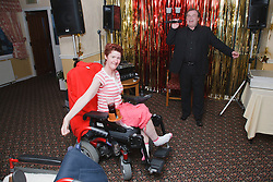 Wheelchair user with cerebral palsy enjoying dancing on holiday in Blackpool.