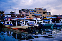 Indonesia, Sulawesi, Manado. Bunaken passenger boats in the harbour.