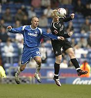 Photo: Aidan Ellis.<br /> Oldham Athletic v Swansea City. Coca Cola League 1. 22/04/2006.<br /> Swansea's Alan Tate beats Oldham's Paul edwards to the ball