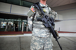 28 August 2012. New Orleans, Louisiana,  USA. .With no mass shelters for city residents, the only occupants of the Ernst N Morial convention center are the Louisiana National Guard. The guard is in place ahead of Hurricane Isaac to provide enhanced security patrols. The 7th year anniversary of Hurricane Katrina is tomorrow and with a storm lurking in the Gulf many have evacuated as an uneasy calm settles over New Orleans..Photo; Charlie Varley.