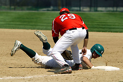 21 April 2007: Josh Bidzinski successfully dives back to 1st base under the tag of Chris Sajdak. Carthage College loses the first game of a double header by a score of 5-2 against the Illinois Wesleyan Titans.