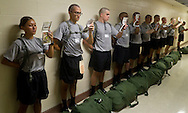 West Point, New York - New cadets study their handbooks while waiting to move on during Reception Day at  the United States Military Academy at West Point on July 2, 2014. The handbook contains information the new cadets need to memorize. About 1,200 cadet candidates, the West Point Class of 2018, reported to the academy to begin their military careers.