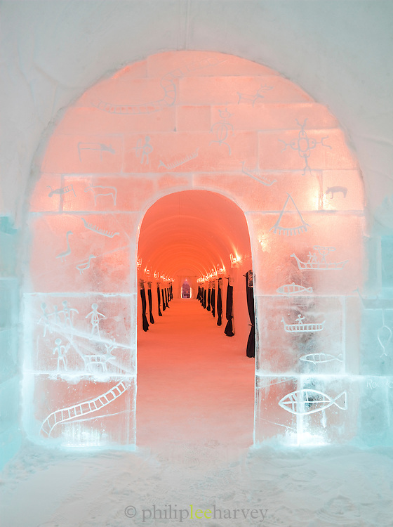 Iced, engraved arch leading to bedrooms at an ice hotel at Alta, Finnmark region, northern Norway