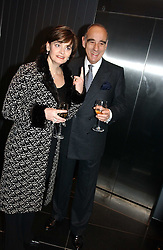 The Swiss ambassador ALEXIS P LAUTENBERG and CHERIE BLAIR at a reception and buffet-dinner hosted by H.E.Alexis P.Lautenberg, Ambassador of Switzerland to celebrate British-Swiss friendship and the forthcoming 'UN International Year of Sport and Physical Education 2005' at 40 St.Mary Axe (The Gherkin) London EC3 on 13th December 2004.<br /><br />NON EXCLUSIVE - WORLD RIGHTS