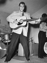 June 7, 2017 - Fort Worth, TX, USA - Elvis Presley plays guitar during a concert in Fort Worth, Texas,  early in his career. (Credit Image: © File/TNS via ZUMA Wire)