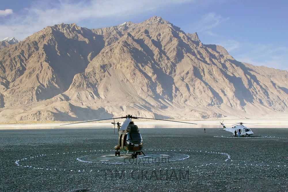 Helicopters on landing pad in Hunza region of Karokoram Mountains, Pakistan