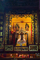 Ornate altars with with offerings and deities in Tian Hou Temple, Ho Chi Minh City.