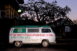 22nd, December 2005. New Orleans Christmas decorations. A VW camper van showing flood levels waits to be towed from Leda Street in Mid City.