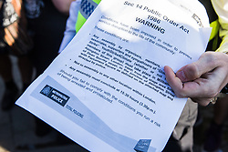 London, UK. 20 September, 2019. Metropolitan Police officers issue warnings under s14 of the Public Order Act 1986 to move students and climate campaigners blocking Lambeth Bridge during the second Global Climate Strike in protest against a lack of urgent action by the UK Government to combat the global climate crisis. The Global Climate Strike grew out of the Fridays for Future movement and is organised in the UK by the UK Student Climate Network.