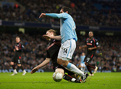 MANCHESTER, ENGLAND - Sunday, February 13, 2010: Manchester City's Roque Santa Cruz is brought down by a Stoke City player, but no penalty was given, during the FA Cup 5th Round match at the City of Manchester Stadium. (Photo by David Rawcliffe/Propaganda)  MANCHESTER, ENGLAND - Sunday, February 13, 2010: Manchester City xxxx and Stoke City's xxxx during the FA Cup 5th Round match at the City of Manchester Stadium. (Photo by David Rawcliffe/Propaganda)