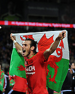 Gareth Bale of Wales celebrates after the match as the Wales team qualify for Euro 2016 finals in France.  Wales v Andorra, Euro 2016 qualifying match at the Cardiff city stadium  in Cardiff, South Wales  on Tuesday 13th October 2015. <br /> pic by  Andrew Orchard, Andrew Orchard sports photography.