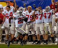 Antonio Pittman runs along the Buckeyes' sideline during a 60-yard touchdown sprint which sealed the win for Ohio State last night in the fourth quarter.
