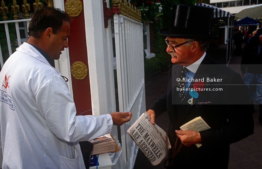 A gentleman buys an edition of the Evening Standard newspaper outside the gates of the Ascot racecourse on Ladies Day at Royal Ascot racing week. The headline 'Maxwells Arrested' refers to the sons of media tycoon Robert Maxwell whose suspicious death triggered fraud allegations to his newspaper empire. Royal Ascot is held every June and is one of the main dates on the sporting calendar and English social season. Over 300,000 people make the annual visit to Berkshire during Royal Ascot week, making this Europe's best-attended race meeting. There are sixteen group races on offer, with at least one Group One event on each of the five days. The Gold Cup is on Ladies' Day on the Thursday. There is over £3 million of prize money on offer.