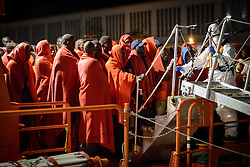October 6, 2018 - Malaga, Spain - A group of migrants disembarking the Spanish vessel at the Malaga's port, on October 6, 2018, Malaga. (Credit Image: © Guillaume Pinon/NurPhoto/ZUMA Press)