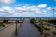 Horizontal landscape beach photo with the Spring Lake NJ  boardwalk in the foreground.