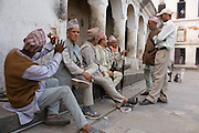 A group of Nepali men pass the time outside the sacred Hindu temple Pashpatinath on May 12, 2008, in Kathmandu, Nepal (David Stubbs / Aurora)