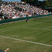 lleyton Hewitt, Australia in action during his three sets to love victory over Robby Ginepri, USA, on a beautiful sunny afternnon during the first round match at the All England Lawn Tennis Championships at Wimbledon, London, England on Tuesday, June 23, 2009. Photo Tim Clayton.