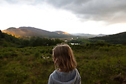 A little girl loks out over a valley with the river Spey below in the Cairngorm National Park south of Newtonmore.