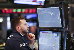 NEW YORK, Feb. 5, 2018  A trader works at the New York Stock Exchange in New York, the United States, on Feb. 5, 2018. U.S. stocks closed sharply lower on Monday, with the Dow plummeting 4.60 percent, as the market took a heavy hit from panic sales. (Credit Image: © Wang Ying/Xinhua via ZUMA Wire)