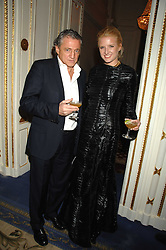 CARLOS ALMADA and FIONA SCARRY at a party to celebrate the launch of The Essential Party Guide held at the Mandarin Oriental Hyde Park, 66 Knightsbridge, London on 27th March 2007.<br /><br />NON EXCLUSIVE - WORLD RIGHTS