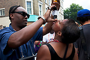 A shot of rum at the Notting Hill Carnival in West London. The Notting Hill Carnival is an annual event which since 1964 has taken place each August, over two days (the August bank holiday Monday and the day beforehand). It is led by members of the West Indian / Caribbrean community, particularly the Trinidadian and Tobagonian British population, many of whom have lived in the area since the 1950s. The carnival has attracted up to 2 million people in the past, making it the second largest street festival in the world. The celebration centres around a parade of floats, dancers and sound systems.