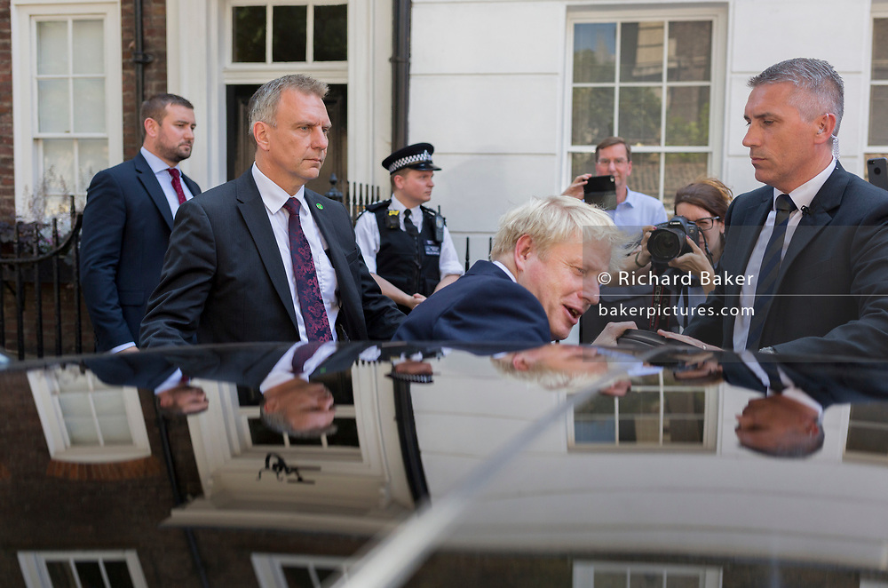 On the day that the Conservative Party elects its leader and the country's Prime Minister, Boris Johnson gets into his car after leaving the property in Great College Street that he and his campaign team have been using (courtesy of Sky TV executive Andrew Griffith), on 23rd July 2019, in Westminster, London, England.