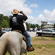RAEFORD, NC - June 6: A man on a horse arrives  to pay respects to George Floyd on the highway outside Impact Church, where a memorial service will be held in his honor in Raeford, NC on June 6, 2020. The 3 day tour will culminate with Floyd's funeral in Houston, Texas. (Photo by Logan Cyrus for AFP)