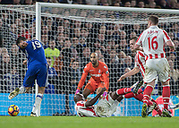 Football - 2016 / 2017 Premier League - Chelsea vs. Stoke City <br /> <br /> Diego Costa of Chelsea drives home his teams fourth goal at Stamford Bridge.<br /> <br /> COLORSPORT/DANIEL BEARHAM