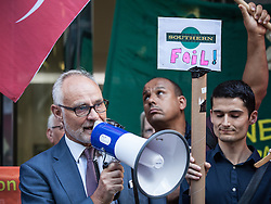 © Licensed to London News Pictures. 10/08/2016. London, UK. Crispin Blunt MP speaks outside the Department for Transport at a protest for 'fairer fares' on train services on Southern Rail. Southern Rail staff have called off the final two days of a week-long strike over job losses and passenger safety. Photo credit: Rob Pinney/LNP