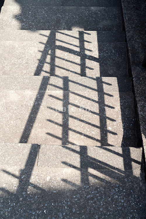 railing shadow on stairs