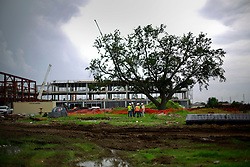 27 August 2014. Lower 9th Ward, New Orleans, Louisiana.<br /> Hurricane Katrina 9 years later. Core Construction brings hope to the largely derelict lower 9th ward as they build the $35 million Dr Martin Luther King Jr Charter High School. The area continues to struggle to recover from Hurricane Katrina.<br /> Photo; Charlie Varley/varleypix.com