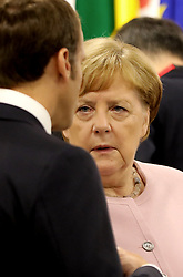 """Emmanuel Macron (French President) and Angela Merkel (German Chancellor) - Side event organized by the Japanese Prime Minister, on the theme """"Promoting the place of women at work"""" at the Intex Osaka congress center at the G20 summit in Osaka, Japan, on June 29, 2019. Photo by Dominque Jacovides/Pool/ABACAPRESS.COM"""
