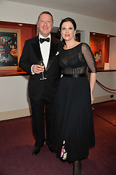 MICHAEL VLAHOVIC Head of Private Banking Central & Eastern Europe at Coutts & Co and OLGA BALAKLEETS at the Russian Ballet Icons Gala at The London Coliseum, 33-35 St.Martin's Lane, London on 9th March 2014.