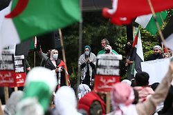 © Licensed to London News Pictures. 29/05/2021. Salford, UK.  Protesters deliver speeches at a 'Protest for Palestine' outside the BBC studios in Media City. Pro-Palestine demonstrations have been taking place worldwide in the wake of Israel's 11 day bombardment of Gaza which resulted in hundreds of civilian deaths. Photo credit: Adam Vaughan/LNP
