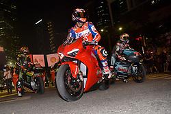 October 31, 2018 - Kuala Lumpur, Malaysia - Italian MotoGP rider Danilo Petrucci of Pramac Ducati Team (C) rides his bike in front of Malaysia landmark Kuala Lumpur twin tower in Kuala Lumpur, Malaysia during a MotoGP pre-event ahead of Malaysian Grand Prix on October 31, 2018. (Credit Image: © Zahim Mohd/NurPhoto via ZUMA Press)