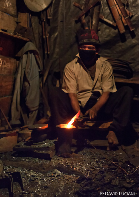 A blacksmith bending a red hot iron in Hapoli, a part of Ziro, and the headquarter of Lower Subansiri District Administration.