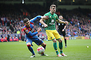 Robbie Brady of Norwich City is intercepted by Joel Ward of Crystal Palace. Barclays Premier League match, Crystal Palace v Norwich city at Selhurst Park in London on Saturday 9th April 2016. pic by John Patrick Fletcher, Andrew Orchard sports photography.