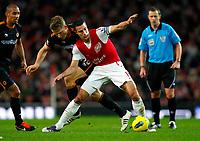 20111227: LONDON, UK - Barclays Premier League 2011/2012: Arsenal vS Wolverhampton Wanderers.<br /> In photo: Robin van Persie of Arsenal holds off Christophe Berra of Wolverhampton Wanderers.<br /> PHOTO: CITYFILES