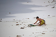 A boy with his surfboard as tourists are removed from the beaches by authorities due he tropical storm Gamma that made landfall in Tulum, which caused several damages due to continuous rains and floods in different parts of Quintana Roo. Red Alert was declared in several Municipalities of the Mexican Caribbean, so authorities enabled shelters for people in vulnerable situations. (Photo by Rodolfo Flores/Speed Media)