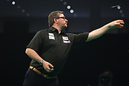 James Wade throws during the Premier League Darts at Marshall Arena, Milton Keynes, United Kingdom on 5 April 2021.