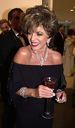 Actress JOAN COLLINS at a dinner in London on<br />  20th June 2000.OFO 141<br /> © Desmond O'Neill Features:- 020 8971 9600<br />    10 Victoria Mews, London.  SW18 3PY <br /> www.donfeatures.com   photos@donfeatures.com<br /> MINIMUM REPRODUCTION FEE AS AGREED.<br /> PHOTOGRAPH BY DOMINIC O'NEILL