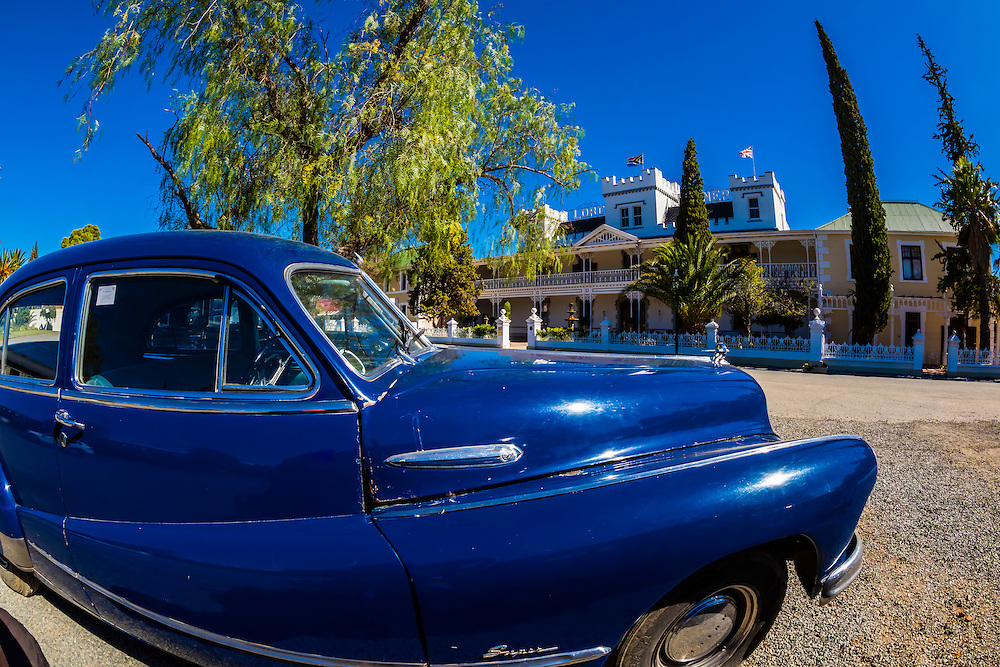 "Vintage cars on display,  Matjiesfontein. Rovos Rail train ""Pride of Africa"" on it's journey between Pretoria and Cape Town, South Africa."