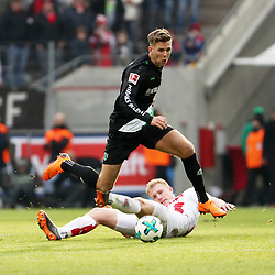 COLOGNE, Feb. 18, 2018  Niclas Fuellkrug (Top) of Hannover and Frederik Soerensen of Koeln vie for the ball during the Bundesliga match between 1. FC Koeln and Hannover 96 in Cologne, Germany, on Feb. 17, 2018. The match ended with a tie 1-1. (Credit Image: © Ulrich Hufnagel/Xinhua via ZUMA Wire)